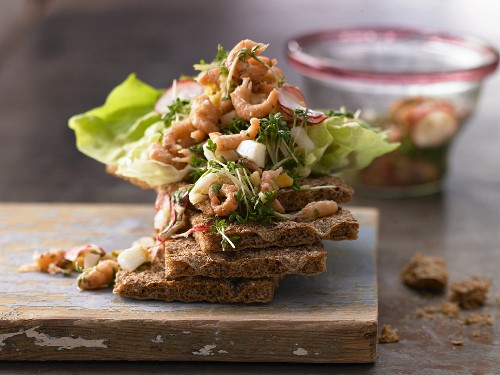 Crab salad with radish, egg and cress on crispbread