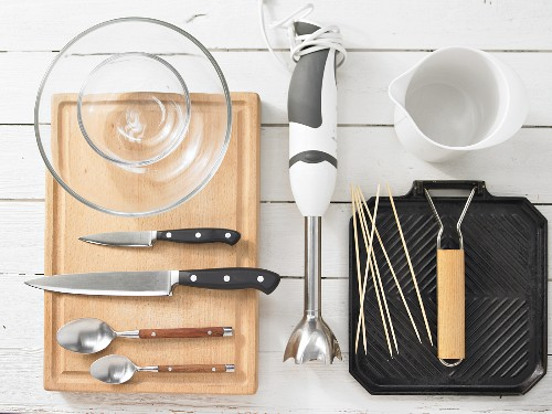 Kitchen utensils for making chicken skewers and tomato salad with avocado and yoghurt cream