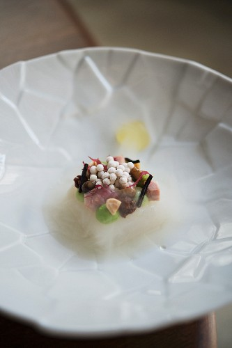 Halibut, oyster pearls, peas, wasabi, pork knuckle stock and elderflower vinegar jelly from the restaurant 'The Table' in Hamburg, Germany
