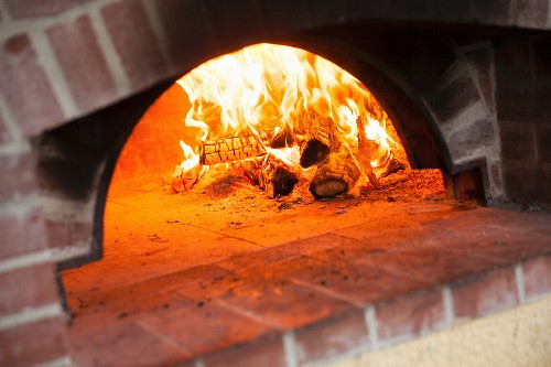 A wood fire oven in a pizzeria