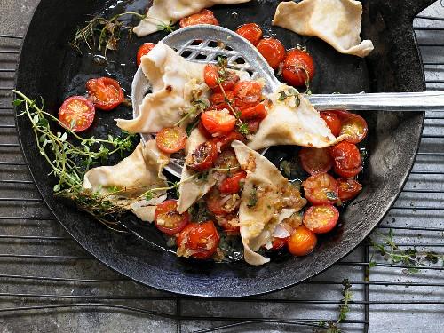 Potato ravioli with stewed cherry tomatoes and thyme
