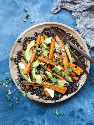 Gluten-free black quinoa salad with avocado and carrot
