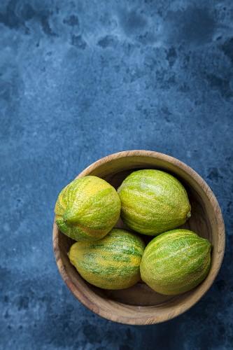 Striped lemons in a wooden bowl