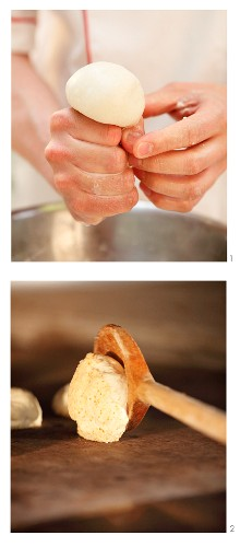 The dough for crusty German 'Allgäuer Knauzen' bread rolls being shaped
