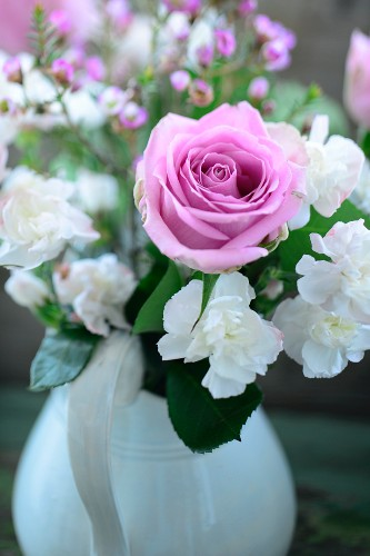 Festive bouquet with pink rose