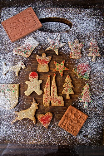 Baking gingerbread Christmas cookies with antique forms