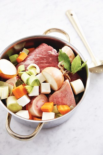 Ingredients for homemade beef stock in a pan