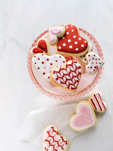 Valentine's heart shaped cookies on pink pedestal