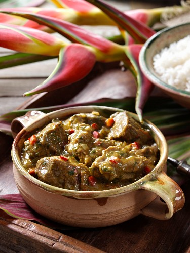 A bowl of Caribbean goat curry editorial food