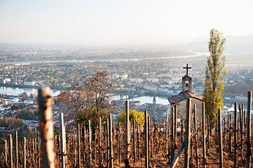 View of the chapel of Hermitage, the town of Tain-Hermitage and the Rhône river (France)