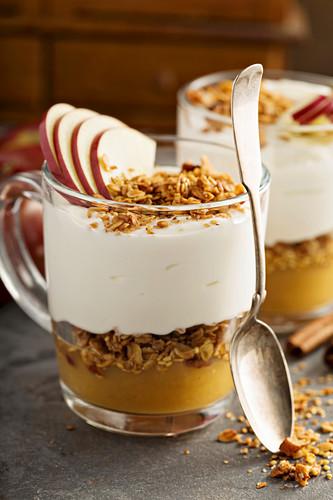 Layered yogurt and applesauce parfait with granola