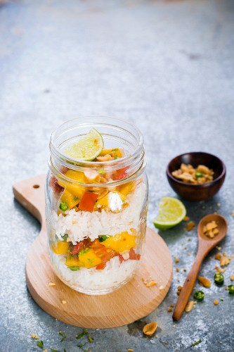 Rice salad with mango and peanuts in a glass jar (Thailand)