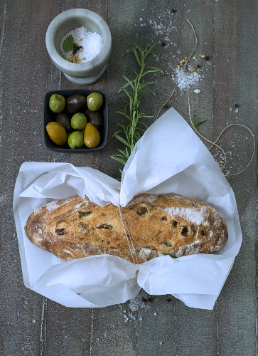 Olive bread wrapped in paper