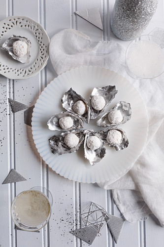 White champagne truffles in silver mussel shells