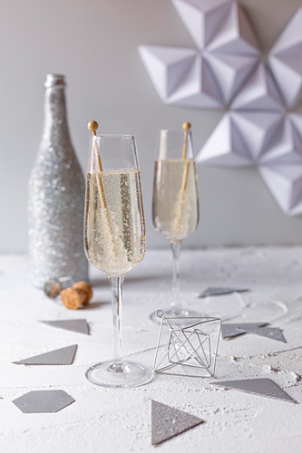 Two glasses of champagne and New Year's Eve decorations