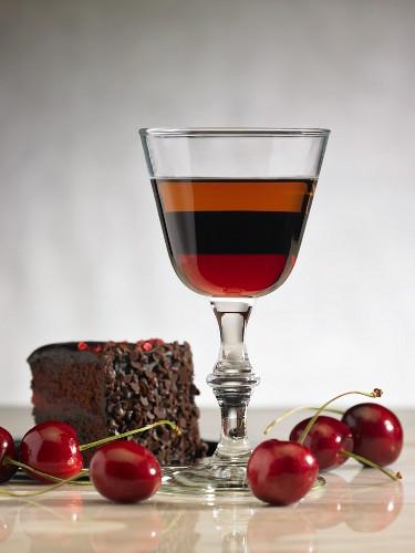 Brandy and a slice of chocolate cherry cake