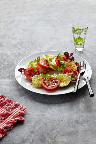 Courgette slices topped with Parmesan and tomatoes