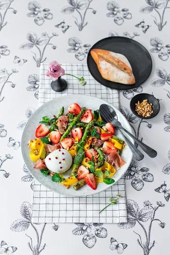 Strawberry and mango salad with asparagus, buffalo mozzarella, parma ham, pink peppercorns and mint