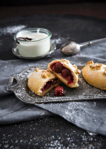Vegan yeast pastries filled with sour cherries and vanilla sauce
