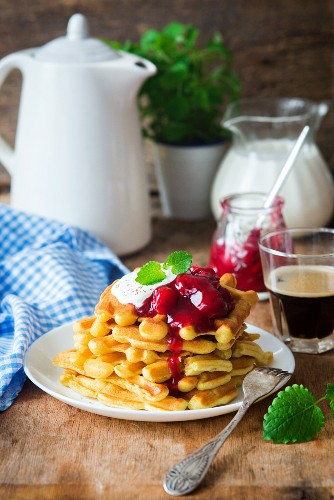 Waffles with cherry sauce