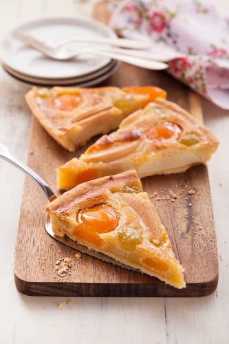 Fruit tart with apricots, pears and grapes