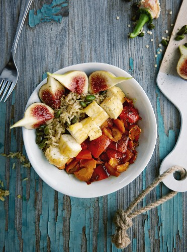 Vegetarian pistachio and rice bowl with halloumi and caramelised vegetables