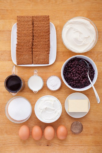 Ingredients for blueberry cheesecake with a biscuit base