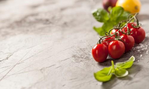 Fresh vegetables on grey rustic background