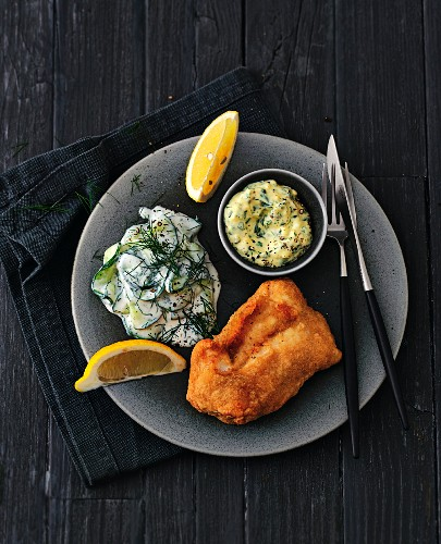 Fish in batter with cucumber salad and tartar sauce