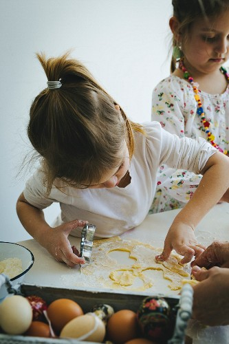 Girl in white shirt making cookies