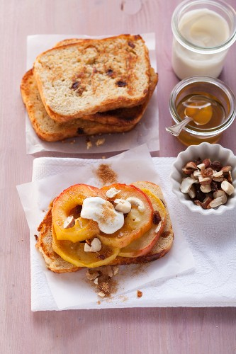Grilled apple slices with nuts, raisins, and yogurt on cinnamon biscuits