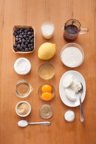 Ingredients for making blueberry pancakes with maple syrup