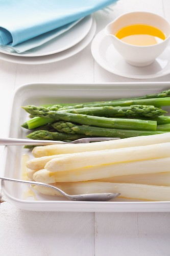 White and green asparagus with butter