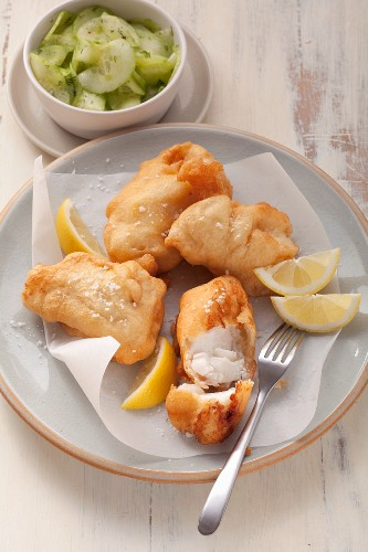 Fried fish in beer batter served with cucumber salad