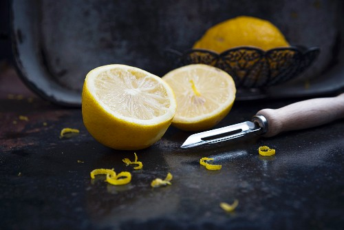 Lemons with zest and a vegetable peeler