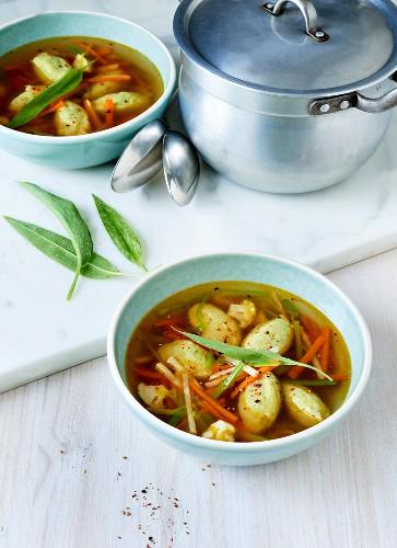 Vegetable broth with wild garlic gnocchi and fresh wild garlic