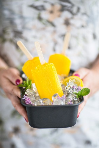 Mango lemon ice popsicles