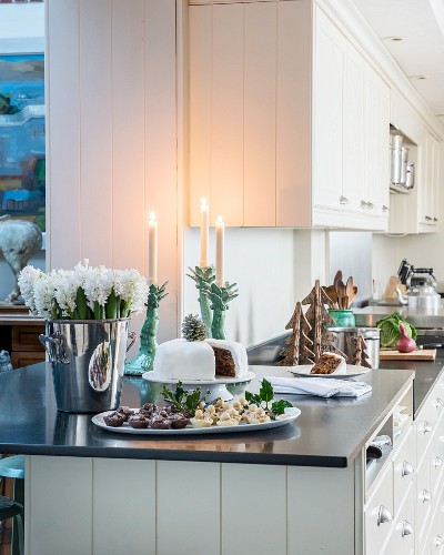 Cake and flowers on festively decorated kitchen counter