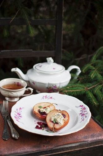 A pan-fried pear filled with cranberry jam and blue cheese