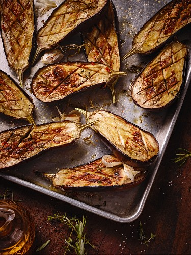 Baked aubergines on baking tray