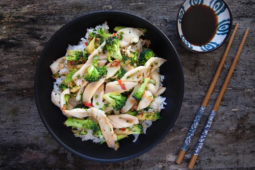 Stir fried squid with broccoli and chilli on a bed of rice