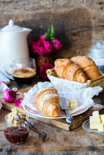 Croissants with jam and butter for breakfast