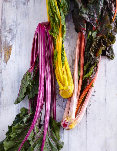 Colourful chard on a white wooden background