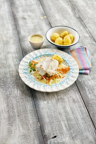 Cod cooked in vegetable stock with mustard sauce