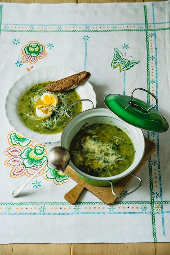 Nine-herb soup served with soft eggs and bread