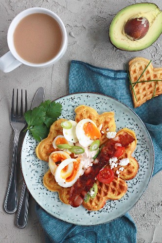 Cheese and curry waffles with hearty toppings; avocado, bacon, egg and coffee