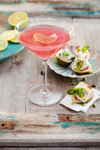 A Cosmopolitan cocktail served with fresh figs and soft goat's cheese