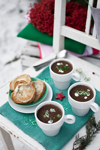 Christmas cream soup made with porcini mushrooms, topped with sour cream and chopped fresch lovage