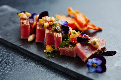 Flash fried tuna on salsa with vegetable crisps