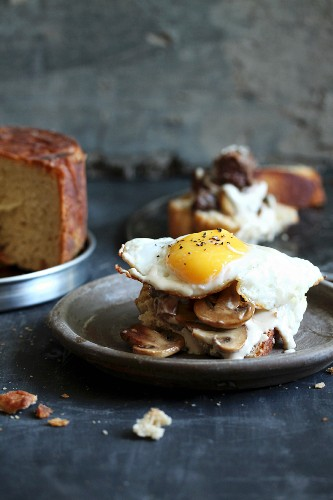 Yeast cake with mushrooms and fried eggs